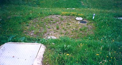 Station d'assainissement groupé. Assainissement rustique avec fosse septique toutes eaux, filtre pouzzolane et filtre à sable non étanche.